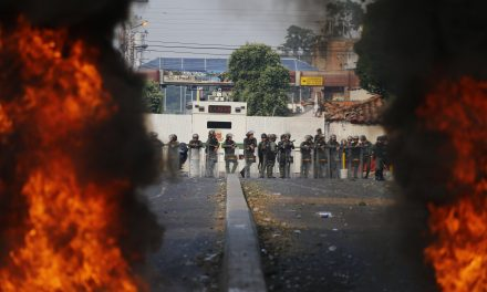 Venezuelan Soldiers Fire Tear Gas at People on the Bridge at the Colombian Border