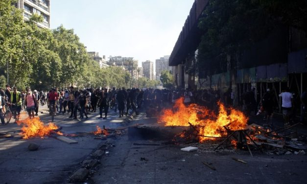 "Chile Is ""At War"" Its President Says, as Continuing Clashes Leave 12 Dead"